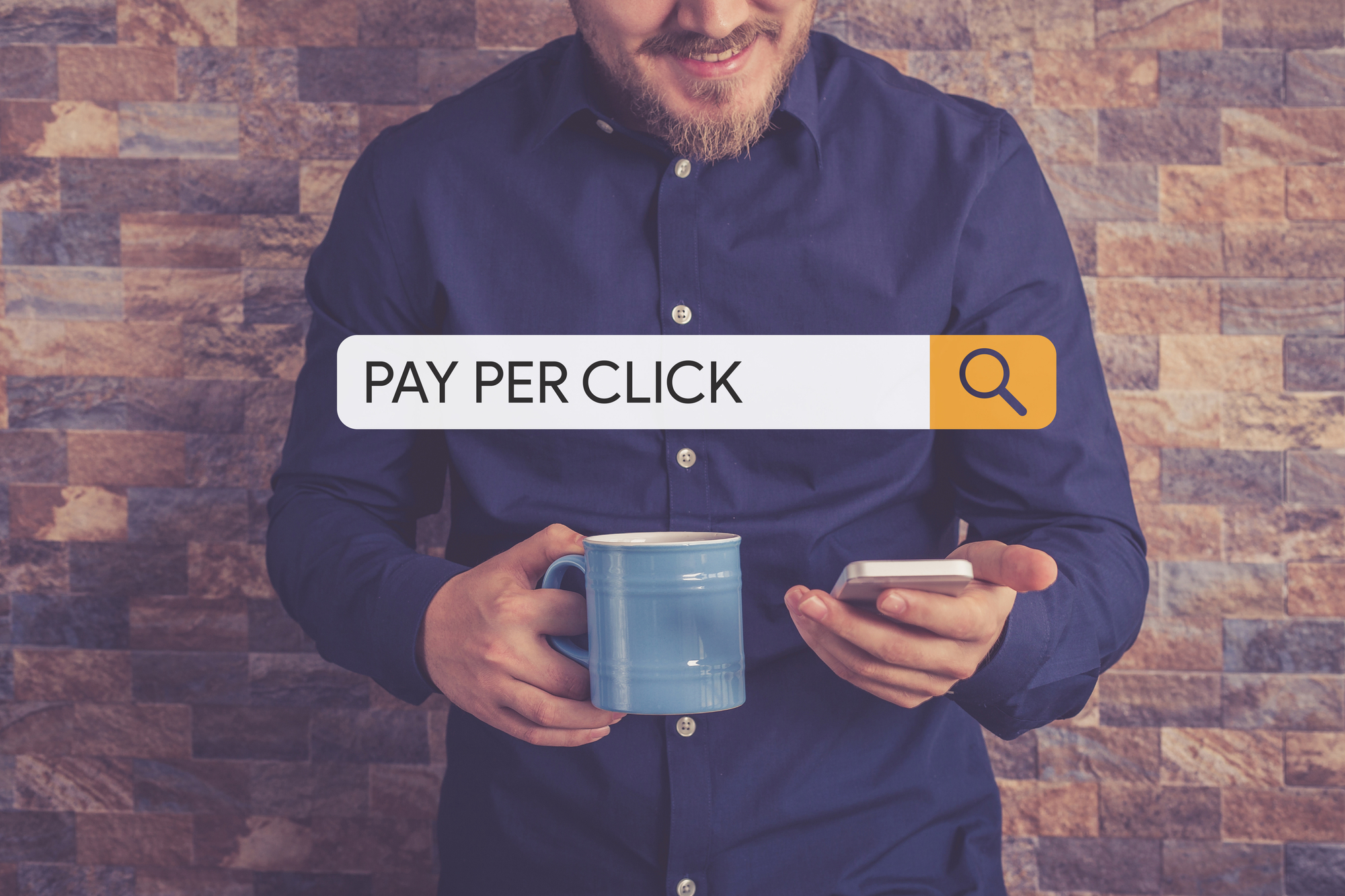 man checking his phone, searching for pay per click services.