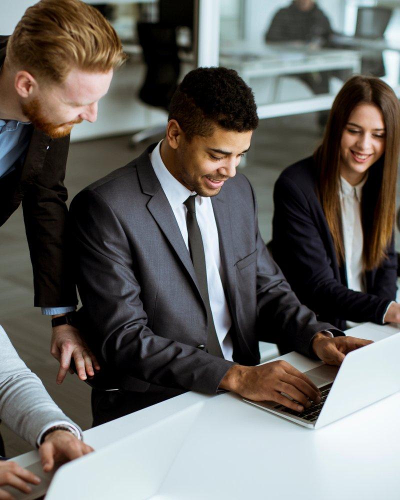business people looking at keyboard